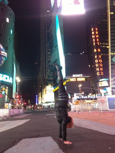 Handstanding in Times Square, 4AM, Dec. 30. The calm before the NYE storm.