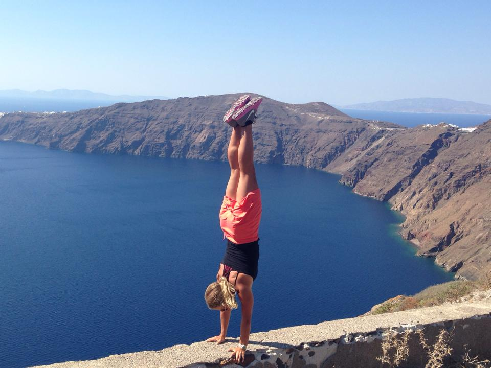 Handstand Steph ventures into the edge of Santorini.