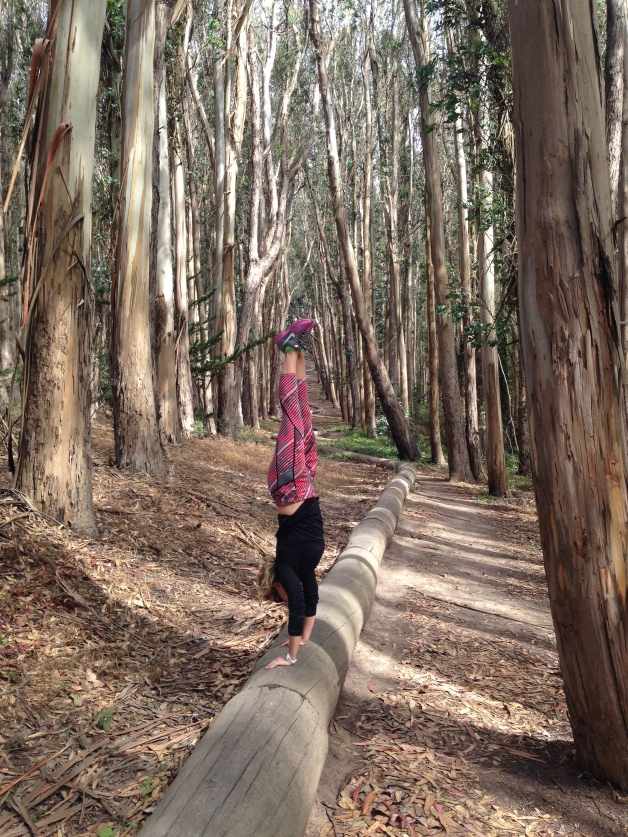 Steph handstanding near Lovers Lane among one of many Presidio paths and trails.