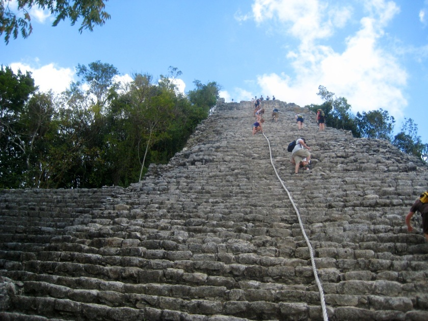 Climbing the pyramid of Chac Mool at Coba near Tulum, Mexico.