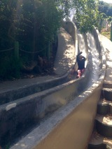 Small at Seward Slides in the Castro. Watch Small land on her butt on the Seward Street Slides.