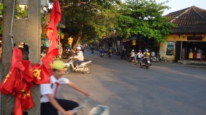 Central Hoi An, Vietnam traffic. Symbols of the past and present in motion.